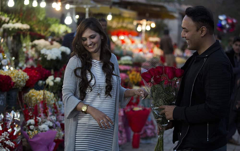 A couple buy flowers to celebrate Valentines Day