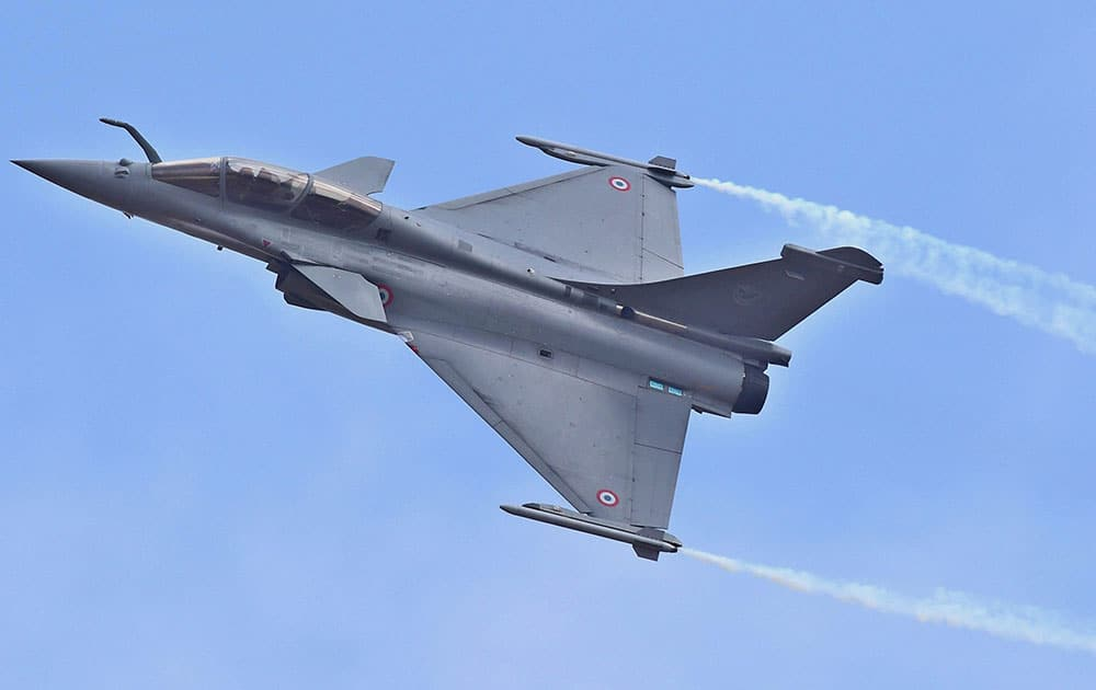 A Rafale fighter aircraft flys during the inauguration of the 11th biennial edition of AERO INDIA 2017