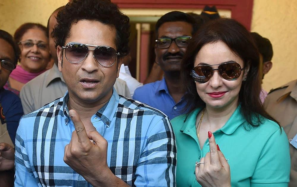 Cricket legend Sachin Tendulkar along with wife Anjali Tendulkar displays the indelible ink mark