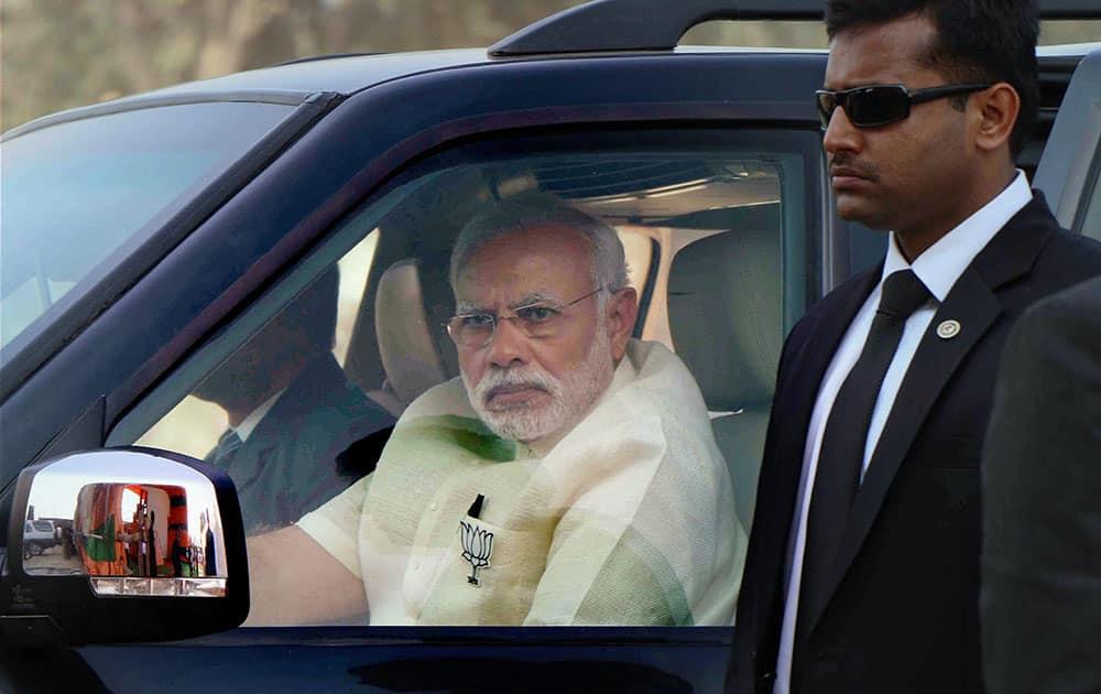 Prime Minister Narendra Modi arrives at an election rally in Phulpur, Uttar Pradesh
