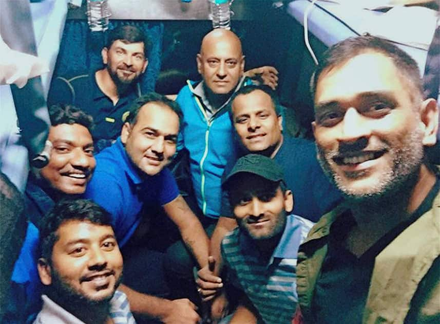 Jharkhand cricket team captain MS Dhoni with his team-mates while travelling in a train to Kolkata