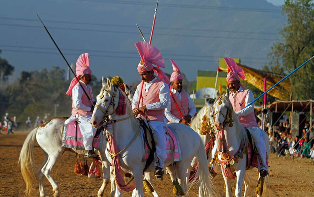 Pakistani riders prepare themselves during a tent pegging competition