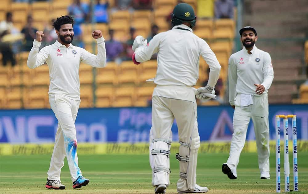 Ravindra Jadeja with team mates celebrate the wicket of Australias Nathan Lyon