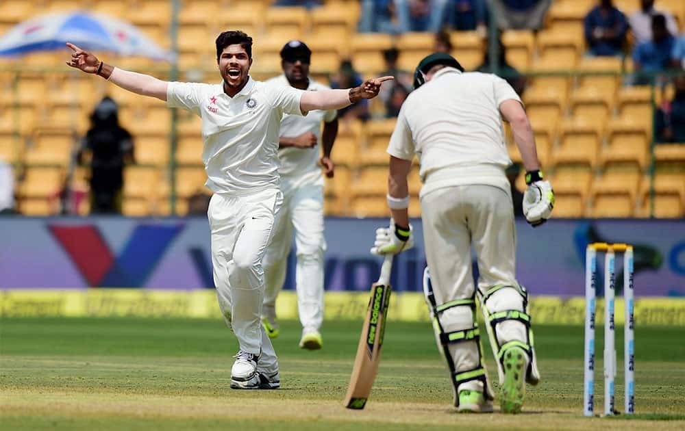 Umesh Yadav celebrates the wicket of Steve Smith