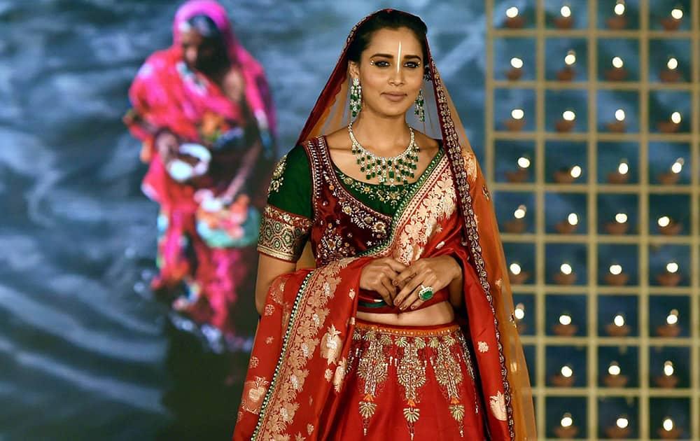Models display creation of designer Anju Modi and Farah Khan Ali
