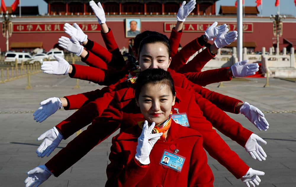 Hospitality staff pose for photos on Tiananmen Square