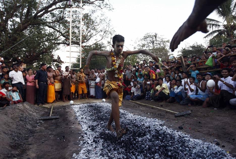 A hindu devotee walks on burning embers