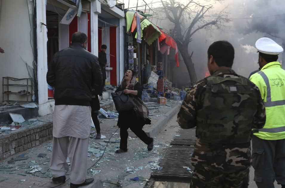 A woman cries after a suicide attack