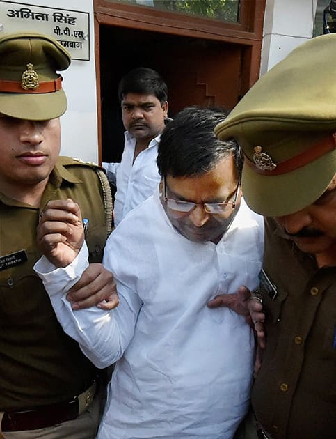 Gayatri Prajapati after being arrested by the police in connection with a rape case in Lucknow