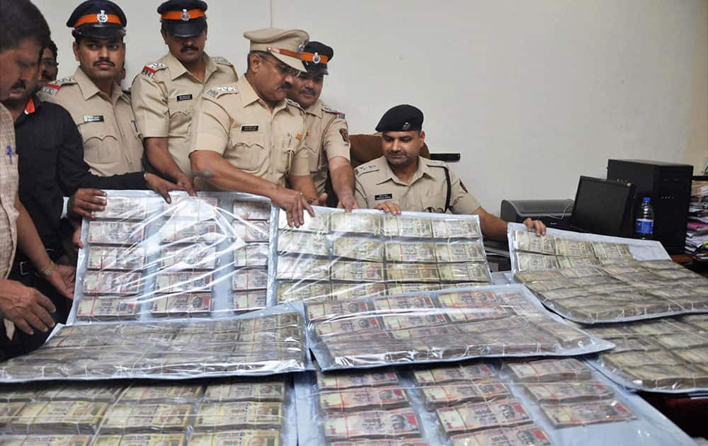 Police shows seized currency notes