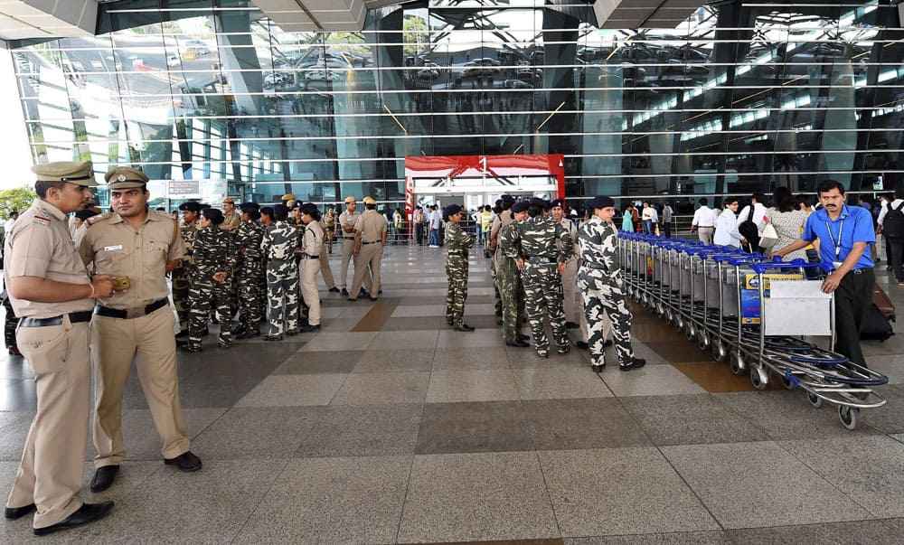 Security personnel stand guard at IGI airport