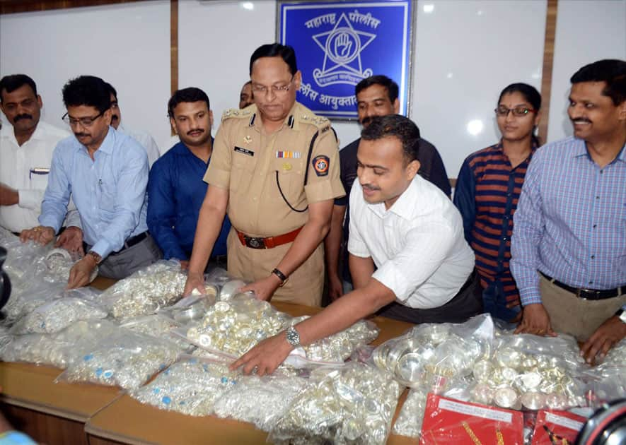 Crime Branch officials display seized silver