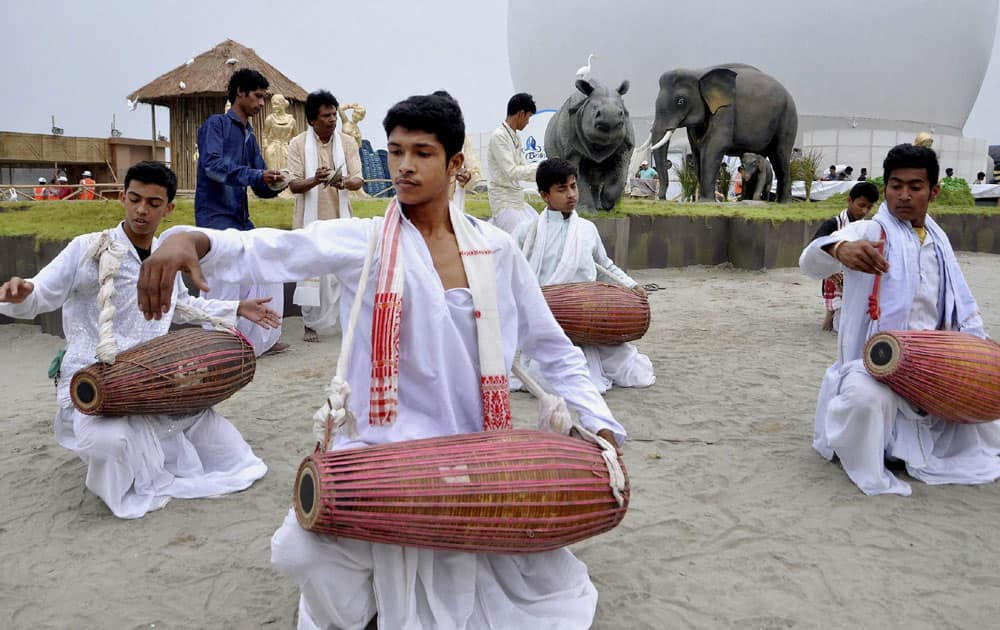 Artists perform during a rehearsal for the Namami Brahmaputra festival