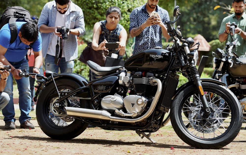 Youngsters click pictures of the Triumph Bonneville Bobber at its launch