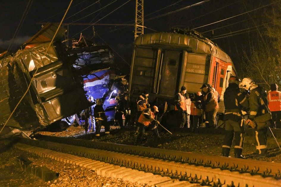 employees examine a train