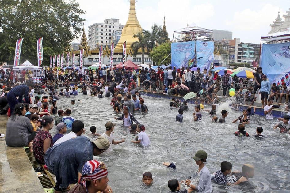 Revelers swim in a pool