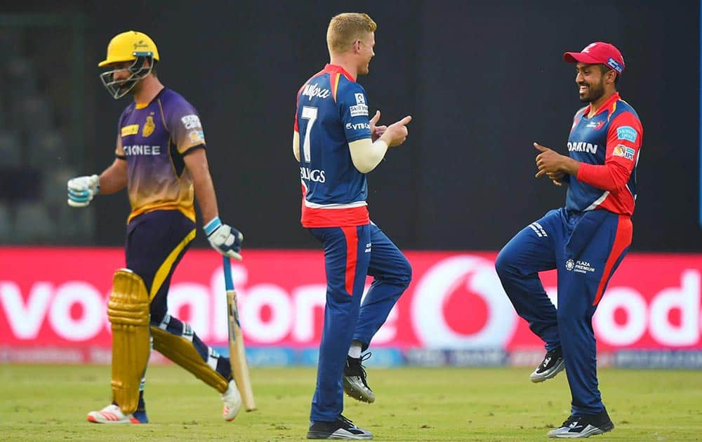 Delhi Daredevils player Sam Billings celebrates with team members after dismissing KKR batsman De Grandhomme