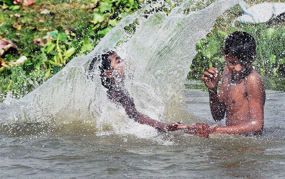 Children bath in Gomti river