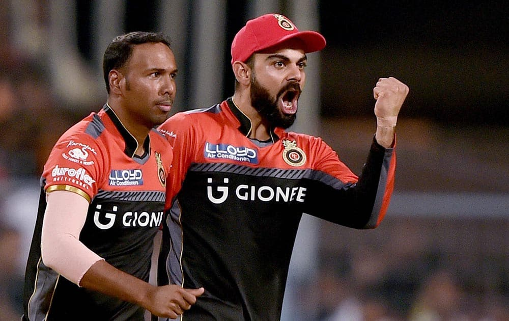 RCB captain Virat Kohli celebrates with bowler S Badree