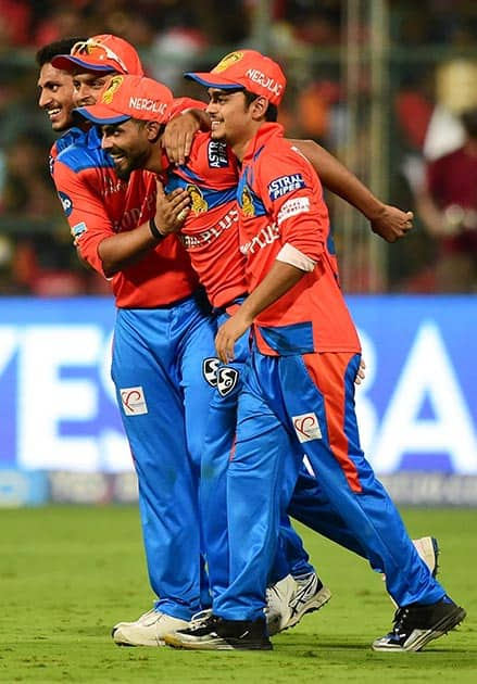 Gujrat Lions Andrew Tye and Basil Thampi celebrates the wicket of Chris Gayle
