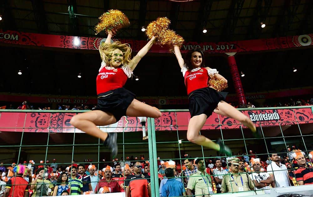 RCB cheerleaders perform before the start of IPL match