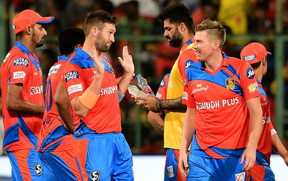 Gujrat Lions Andrew Tye celebrates the wicket of Chris Gayle during the IPL 10