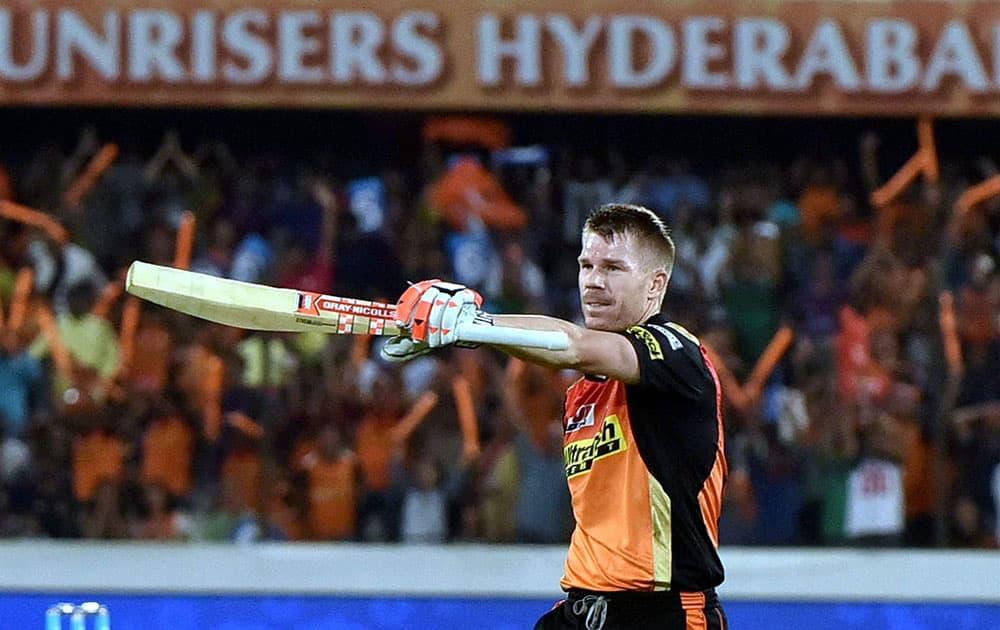 David Warner celebrates his century during their IPL match