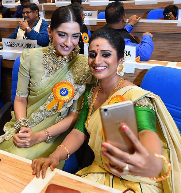 Best actress award winner Surabhi Jyoti takes selfie with actress Sonam Kapoor at the 64th National Film Awards function