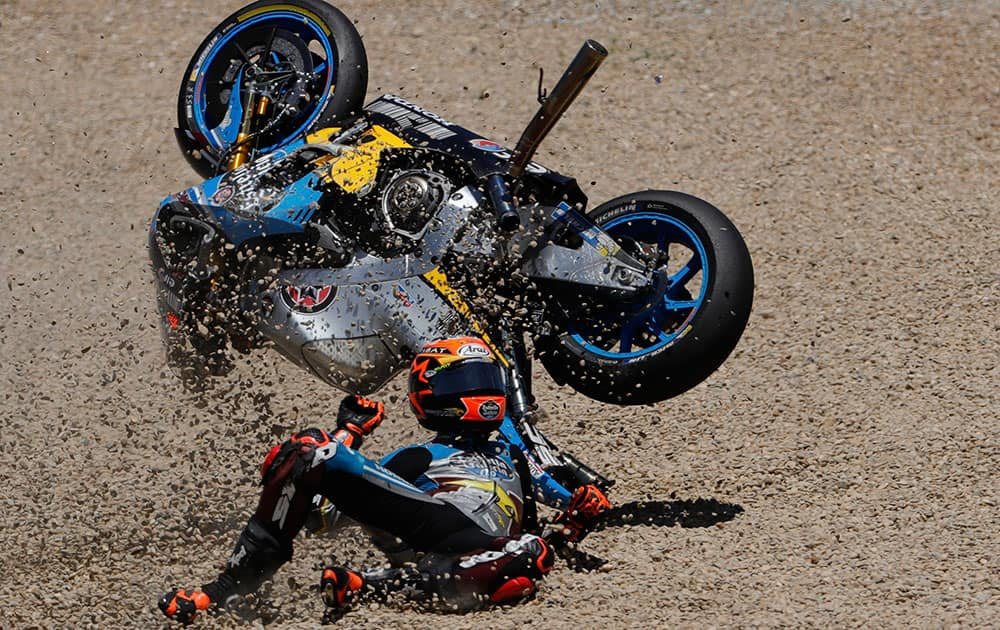 MotoGP rider Tito Rabat of Spain falls from his bike