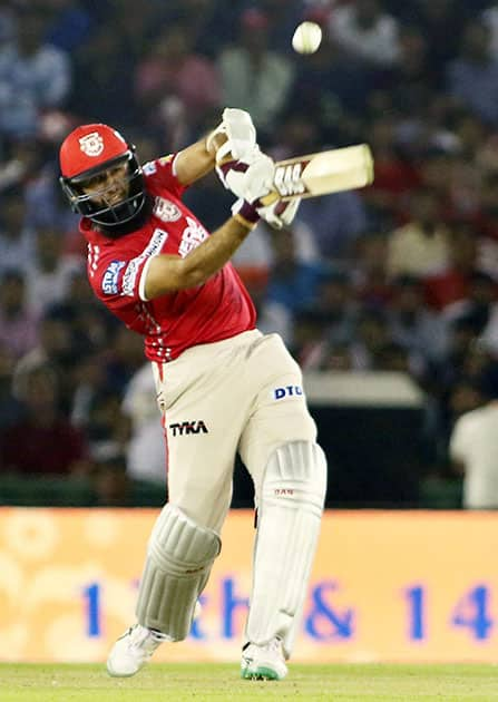 Hashim Amala of Kings XI Punjab plays a shot during the IPL match