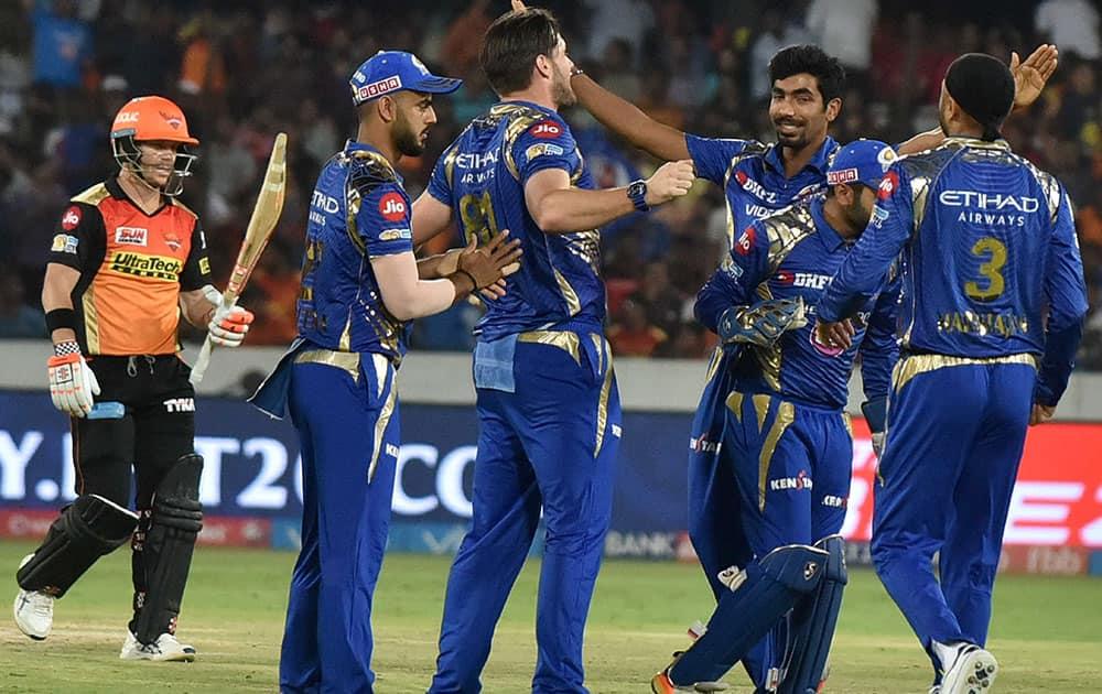 Mumbai Indians cricketers celebrate wicket of DA Warner