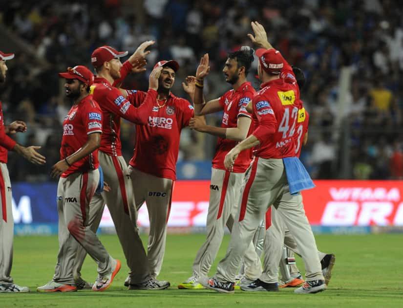 Kings XI Punjab players celebrates fall of a wicket