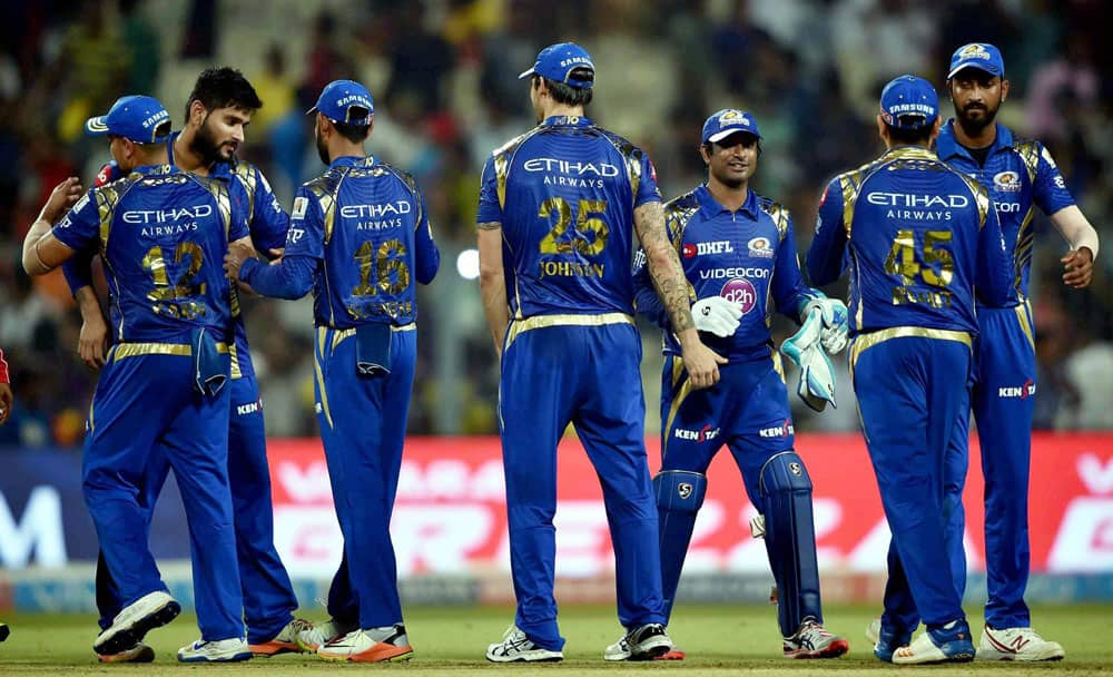 Mumbai Indians cricketers celebrate their win