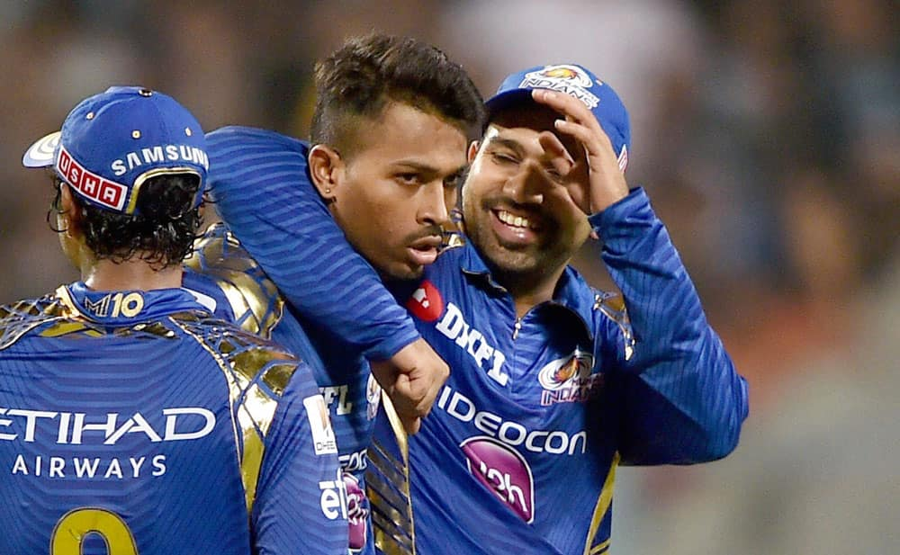 Rohit Sharma celebrates with team mate H.Pandya