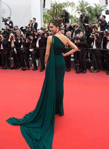 Indian actress Deepika Padukone poses on the red carpet
