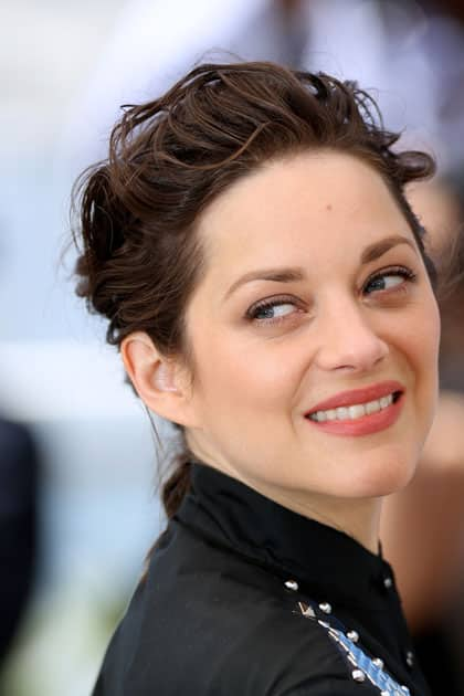 Actress Marion Cotillard poses during a photocall for the film