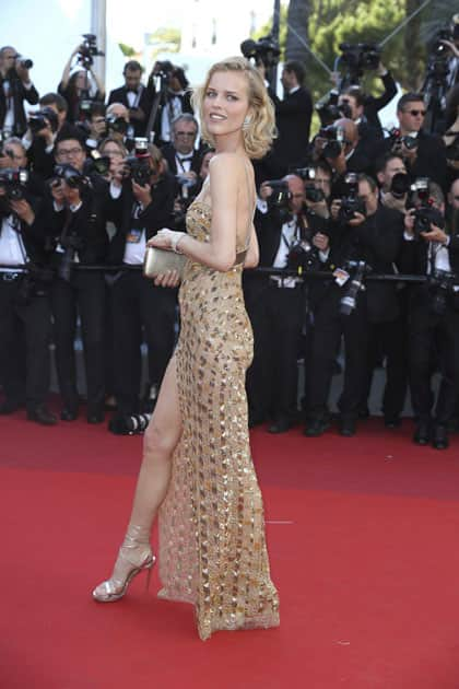 Model Eva Herzigova poses for photographers upon arrival at the opening ceremony