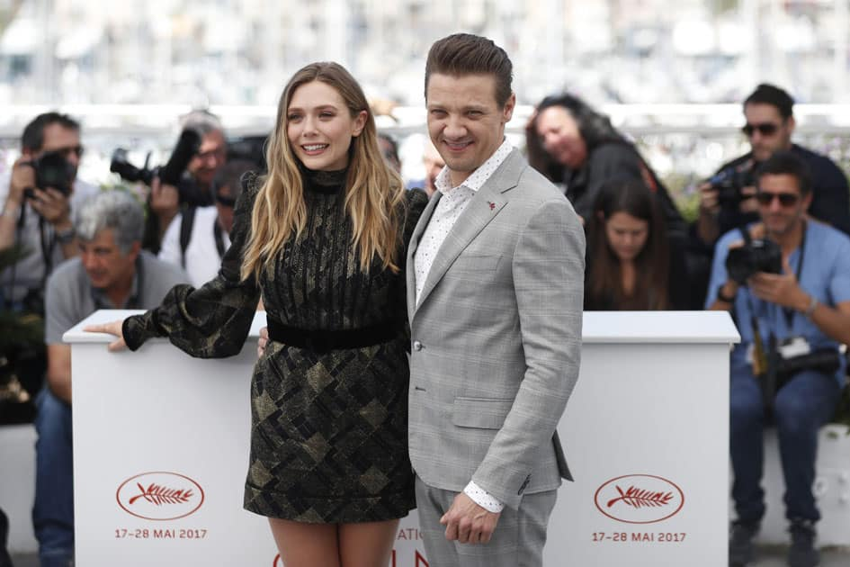 Actors Elizabeth Olsen and Jeremy Renner pose for photographers