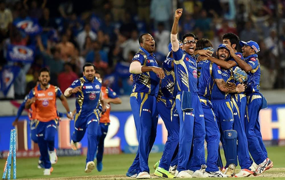 Mumbai Indians players celebrate after winning the IPL 10 Final match