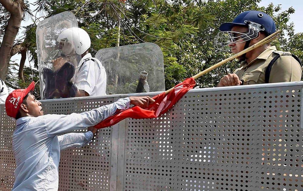 A Left Front activist attacks Murlidhar Sharma, deputy commissioner, STF of the Kolkata Police