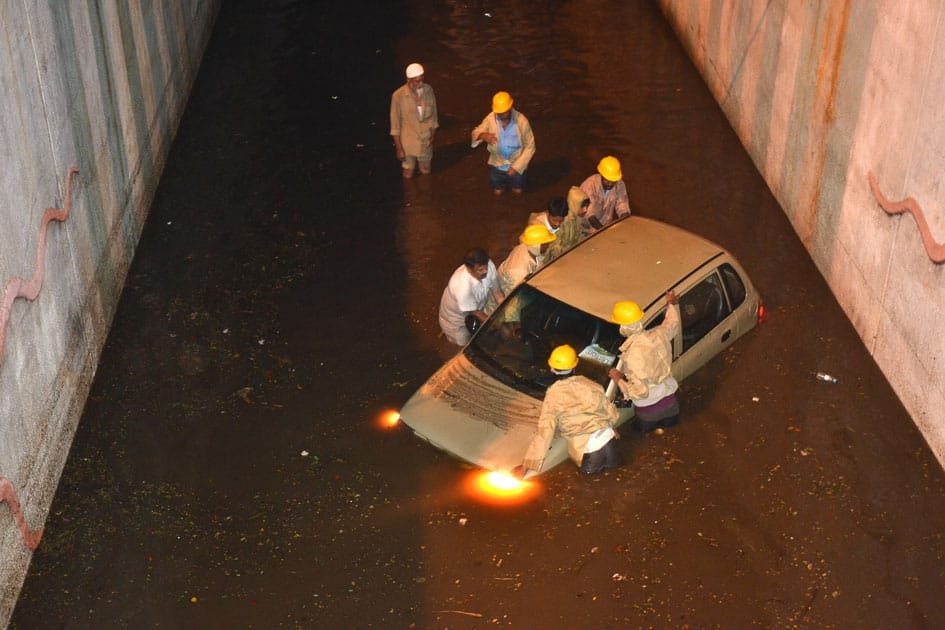 A car gets stuck in waterlogged underpass in Bengaluru