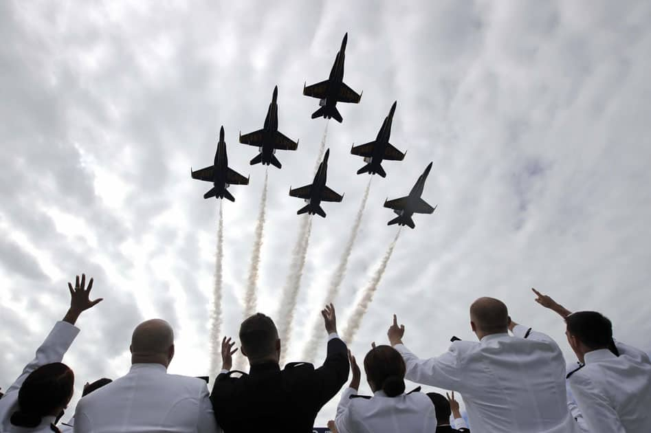U.S. Navy Blue Angels perform a flyover above graduating U.S. Naval Academy midshipmen