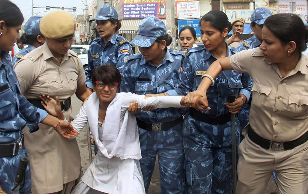 Police women try to remove one of the girls