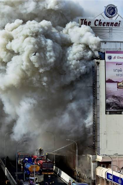Fire personnel dousing a massive fire that broke out at a textiles shops