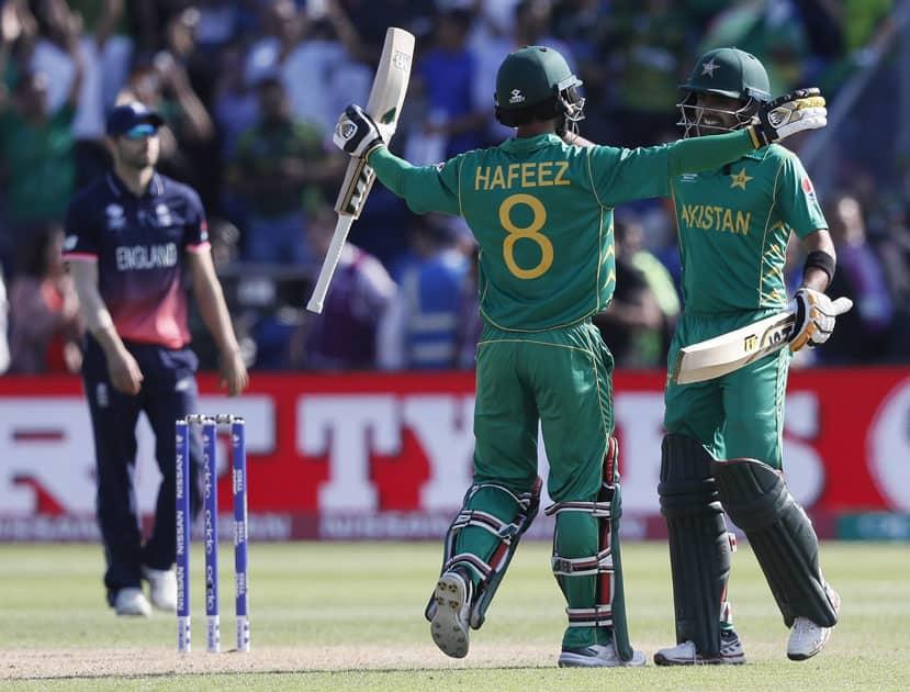 Pakistans Mohammad Hafeez and Babar Azam celebrate winning
