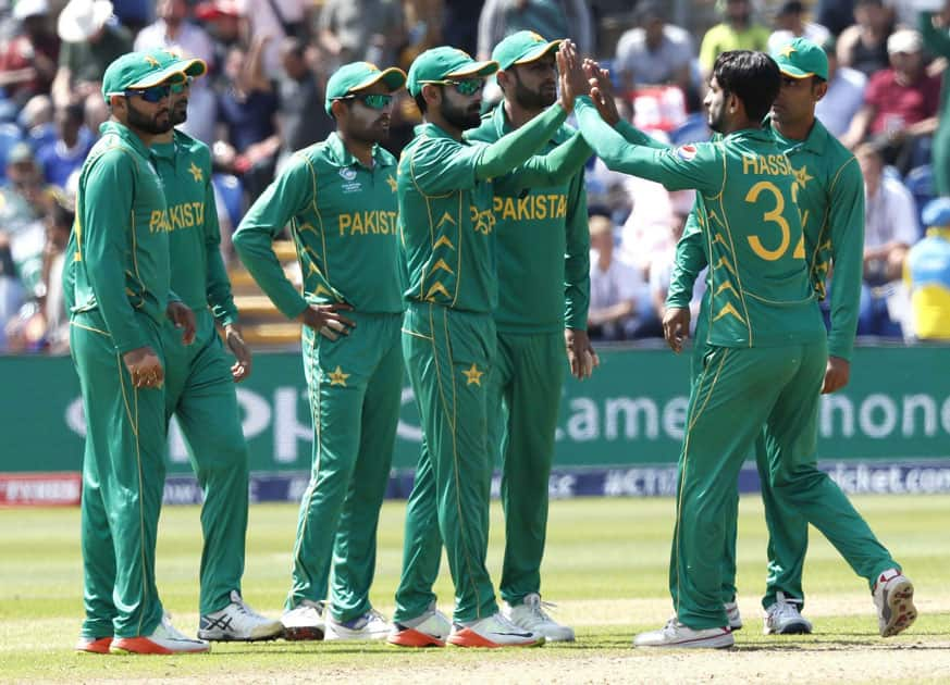 Pakistans players celebrate after taking the wicket