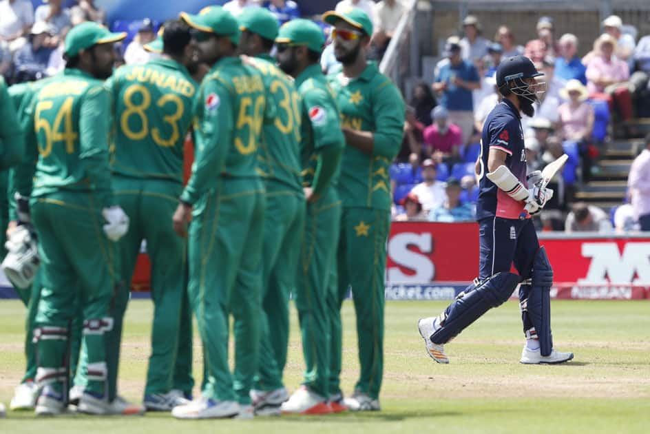 Englands Moeen Ali leaves the pitch after being caught out