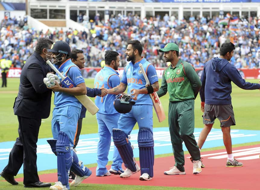 India and Bangladesh players shake hands at the end of semifinal match