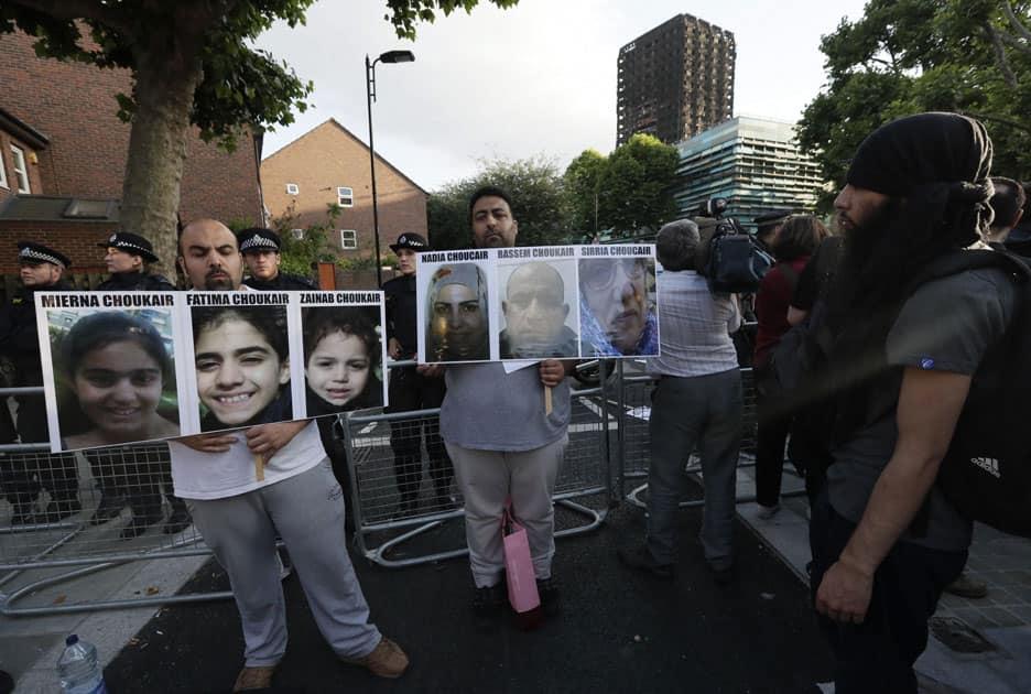 Men display photos of missing family members