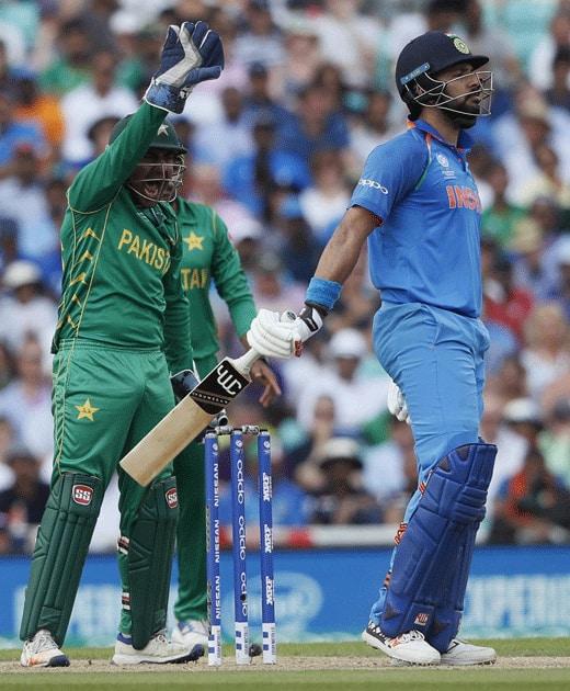 wicket keeper Sarfraz Ahmed celebrates the dismissal of Yuvraj Singh